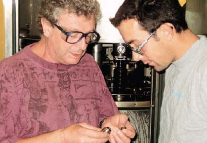 Figure 2. Michel Blondel (left) credits change in material with boosting filling-machine seal life more than fifty-fold.