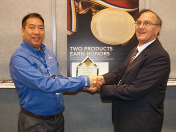 Al Lee (left), DeltaV Platform Business Development Manager for Emerson Process Management accepting a Vaaler Award for DeltaV Virtual Studio from Mark Rosenzweig, Editor in Chief of Chemical Processing.  The DeltaV Virtual Studio won in the Software and Internet Technologies Category.
