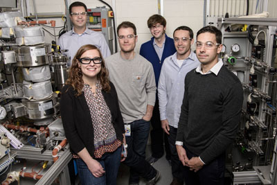 NREL Team -- Pictured from left to right are Adam Bratis, Violeta Sànchez i Nogué, Todd Eaton, Gregg Beckham, Vassili Vorotnikov, and Eric Karp, part of the NREL team working on a cost-competitive, sustainable process for creating acrylonitrile and carbon fibers from renewable biomass.  Source: Dennis Schroeder, NREL.