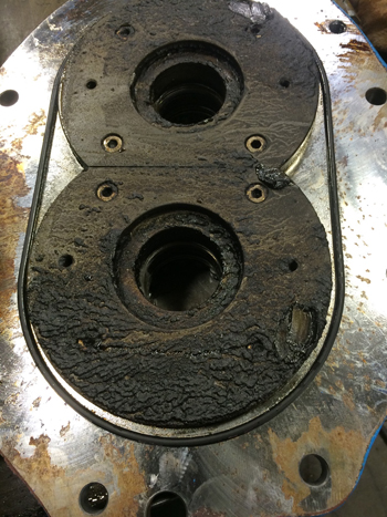 Process Buildup -- Figure 3. Accumulation of baked-on material can eliminate essential clearances and lead to pump failure.