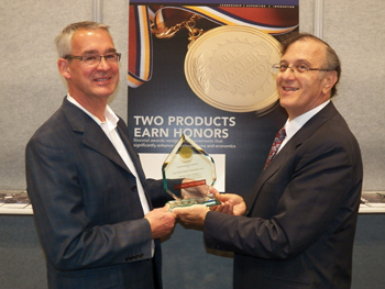 Rick Frauton (left), senior product marketing manager of United Electric Controls, accepting the Vaaler Award for the One Series Safety Transmitter from Chemical Processing Editor in Chief Mark Rosenzweig. The One Series Safety Transmitter won in the Instrumentation and Controls category.
