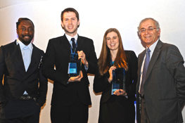 Winners Presented Trophies -- Charles Elachi (far right), director of the Jet Propulsion Laboratory, and entertainer Will.i.am (far left) present trophies to Katie Speights (middle right), a chemical engineering student at the University of Texas at Austin and Paul Clarkson (middle left) of Rolls-Royce, Derby, U.K., for their videos promoting chemical engineering.