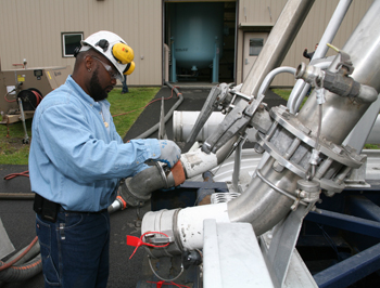 FIELD SERVICE -- Figure 1. Vendor usually handles the installation of fresh activated carbon.
